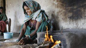 Woman cooking on stove